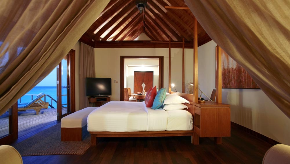 Anantara Sunrise Over Water Suite bedroom