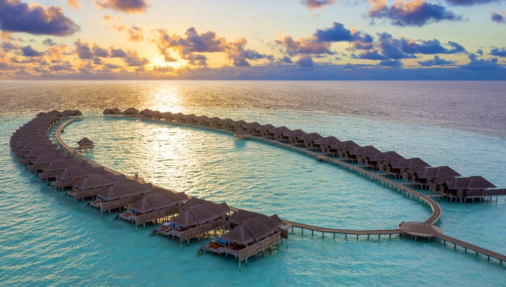 Anantara Kihavah Over Water Villas Sunset aerial
